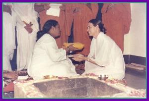 Nirmalamrita receiving her yellow robes.