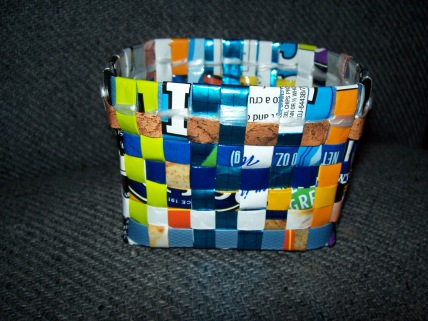 Made from coffee and chip bags, strap and newspaper wrapper