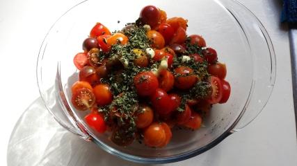 Add oregano and garlic cloves