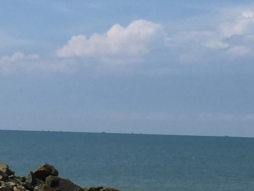 Those are fishing boats on the horizon.